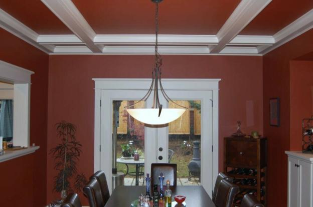 Nantucket dining room tranformed after adding Cape Cod red paint and white satin impervo oil paint